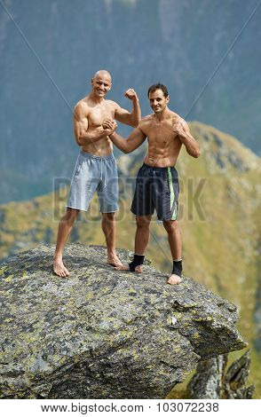 Kickboxers Or Muay Thai Fighters On A Mountain Cliff