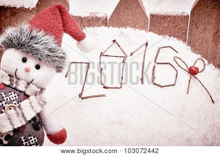 New Year 2016. Merry Christmas. Happy Snowman peeking on snow