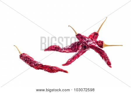Red dry chilli peppers on white background