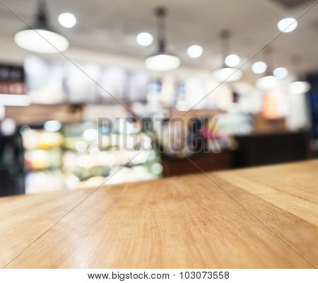 Table Top Counter With Blurred Coffee Shop Cafe Interior Background