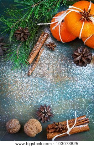 Christmas Card: Tangerines, Walnuts And Cinnamon On A Blue Background,  With Space For Text