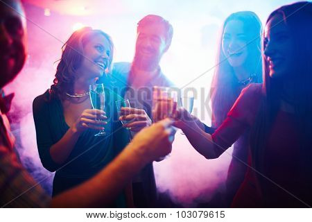 Group of happy friends with champagne having fun at party