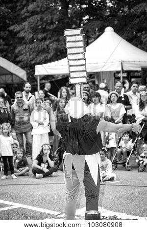Juggler street artist. Black and white photo