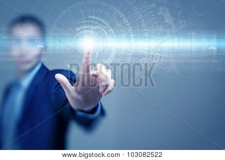 Portrait of businessman touching virtual panel with finger