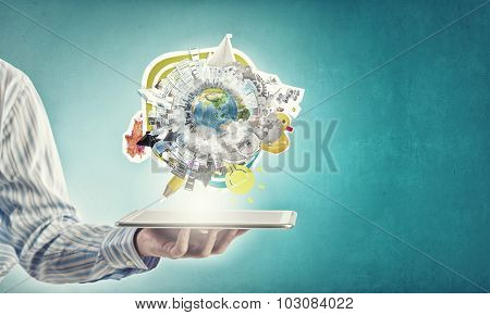 Businessman hands holding tablet pc with Earth planet on it. Elements of this image are furnished by NASA