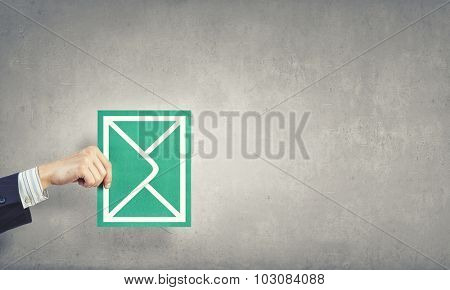 Hand holding envelope card representing email concept