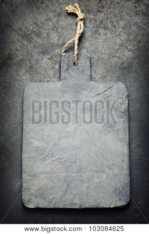 vintage cutting board with space for text on old metal background, close-up