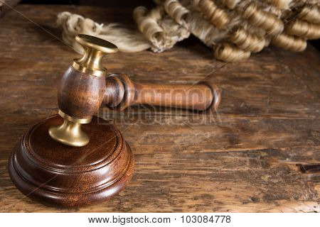 Judge's hammer or gavel and his horsehair wig