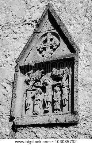 Evangelical subject medieval bas-relief on ancient church wall