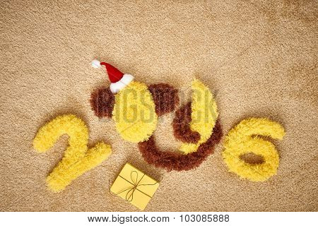 New Year 2016. Christmas.Funny monkey with banana, decoration