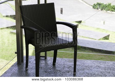 Black Rattan Chair On The Terrace