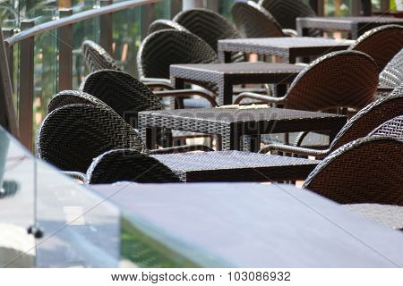 Black Rattan Table And Chair On The Terrace