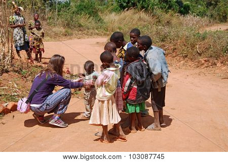 A Volunteer Female Doctor Visit An African Child