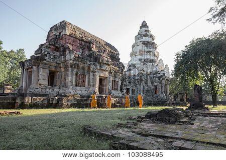 Unidentified Thai Monks Walking At Phanomwan Historical Park