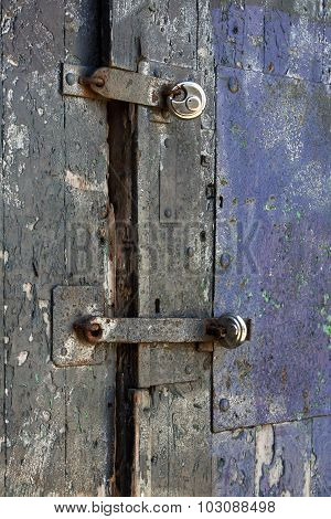 Padlocks On An Old Wooden Door