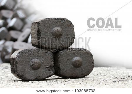 Brown coal briquettes as a industrial background with space for your text.