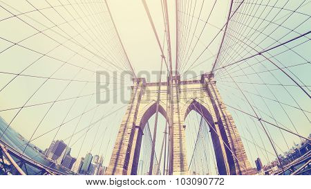 Retro Stylized Photo Of Brooklyn Bridge, Fisheye Lens, Nyc, Usa.