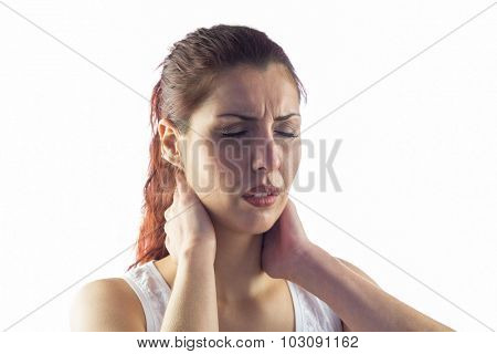 Close-up of woman holding neck against white background