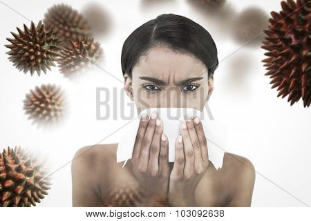 Sick gorgeous model blowing her nose against virus