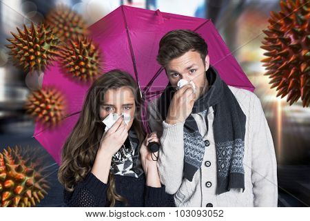 Couple blowing nose while holding umbrella against blurry new york street