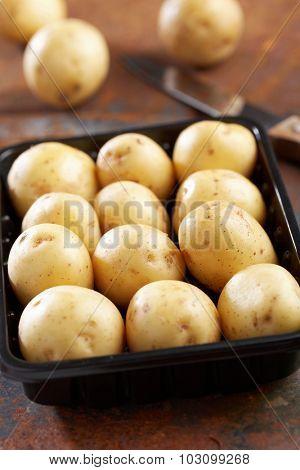 New potato in a plastic tray
