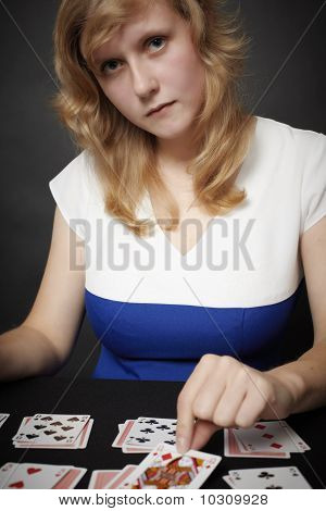 Young Woman Lays Card Game