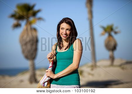 Young woman walking in a beach town