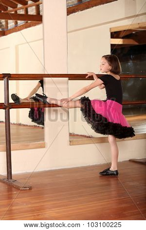 Young little girl ballet dancing