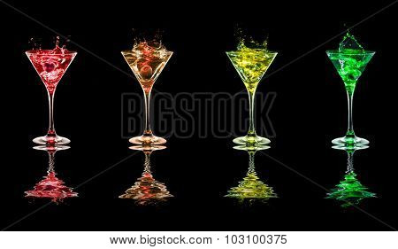 Multicolored Bright cocktails in glasses on black background with reflection