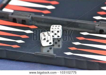 Two dice with the number six on field Backgammon