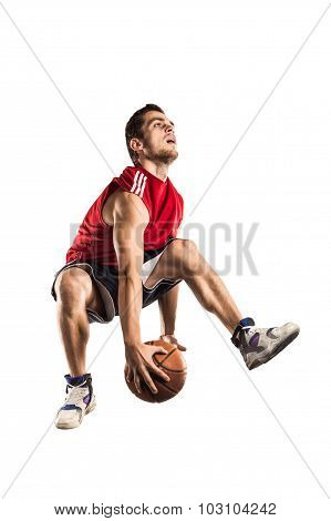 Basketball player jumping and dribbling isolated on white