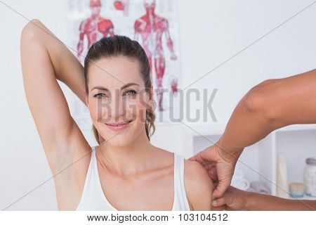 Doctor examining his patient arm in medical office