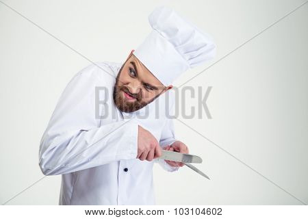Portrait of a male chef cook sharpening knife isolated on a white background