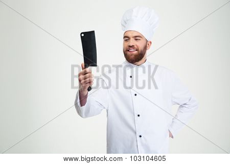 Portrait of a happy male chef cook holding big knife cleaver isolated on a white background