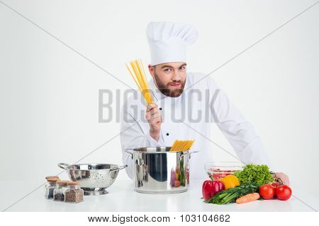 Portrait of a male chef cook preparing pasta isolated on a whtie background