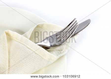 Close Up Dinning Silverware Fork And Knife With Dish On White Background And Text Space, Symbolic Of