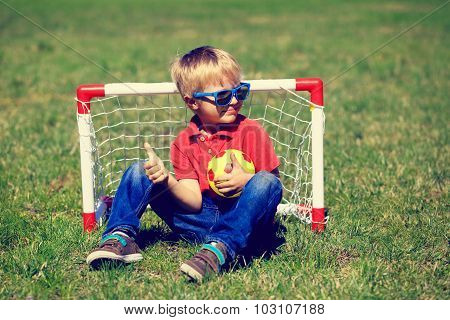 happy little boy enjoy playing football