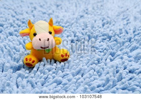 Toy cow on carpet