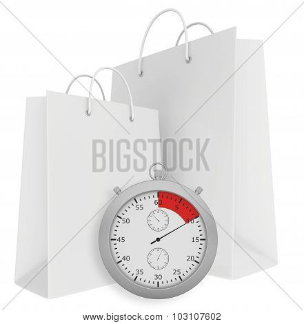 Stopwatch with paper bags isolated on white background