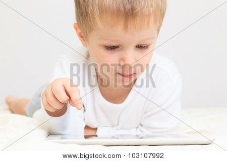 Little boy with touch pad, early education