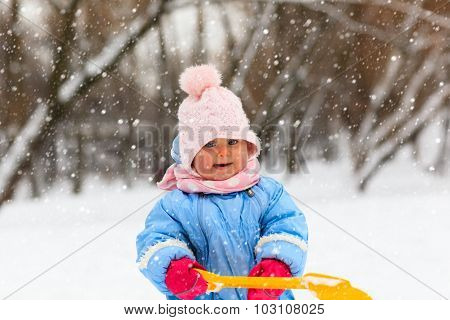 cute little toddler girl play in winter