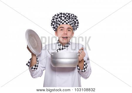 Young chef holding pan isolated on white