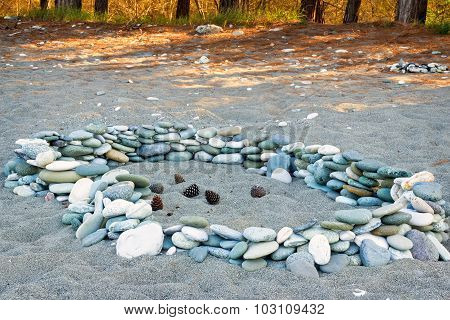 Sea Stones On The Beach And Pine Cones.