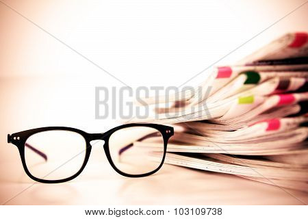 Selective Focus On Reading Eyeglasses With Stacking Of Newspaper Background ,business Information Co