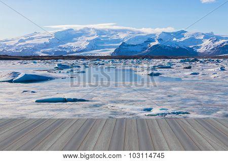 Opening wooden floor, Jokulsarlon glacial with snow mountain