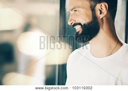 Portrait of a bearded man close to the window
