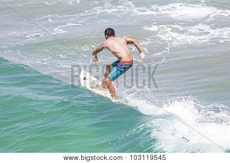 Man Riding Wave At Venice Beach.