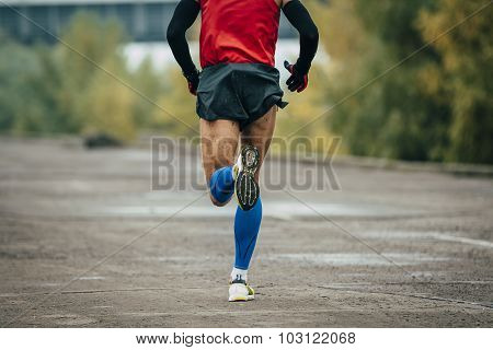 young man runs through streets