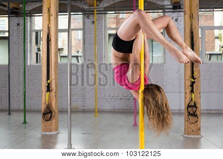 Flexible Woman Doing Pole Dance