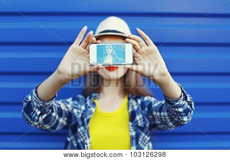Pretty Girl Makes Self-portrait On The Smartphone In The City Over Blue, Screen View